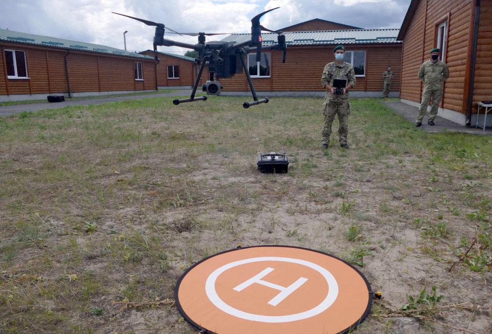 Разминирование с помощью дронов: Пограничники исследуют новый метод, который хотят применить на Донбассе, - ФОТО, фото-1